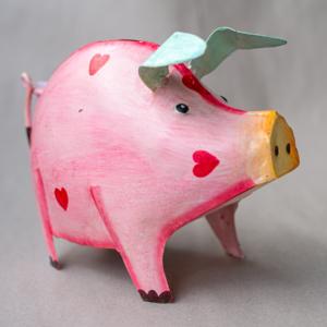 Dekoratives Metall-Sparschwein mit Herzen